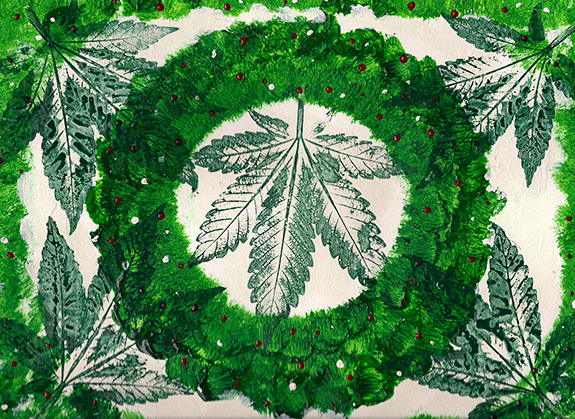 A piece of graphic art has green stamped cannabis leaves alongside and on top of a bright evergreen wreath in the middle of the frame. There are very small white and red berries adorning the wreath.